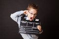 Little boy holding clapper board in hands cinema concept Royalty Free Stock Photography