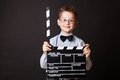 Little boy holding clapper board in hands cinema concept Stock Photo
