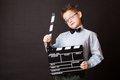 Little boy holding clapper board in hands cinema concept Royalty Free Stock Image