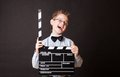Little boy holding clapper board in hands cinema concept Royalty Free Stock Photos