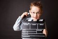 Little boy holding clapper board in hands cinema concept Stock Images