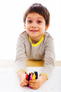 Little boy holding couple colored pencils preparing to draw Royalty Free Stock Photography