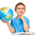 Little boy is holding globe while daydreaming isolated over white Royalty Free Stock Images