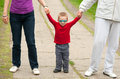 Little boy holding hands of his parents Royalty Free Stock Photos