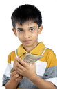 Little boy holding the money indian with expression Stock Photos