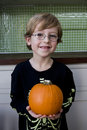 Little boy holding an orange Hallowe'en pumpkin Royalty Free Stock Photo
