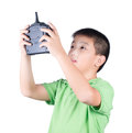 Little boy holding a radio remote control (controlling handset) for helicopter , drone or plane Isolated Royalty Free Stock Photo