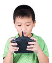 Little boy holding a radio remote control (controlling handset) for helicopter , drone or plane Isolated on white background Royalty Free Stock Photo