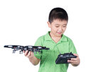 Little boy holding a radio remote control controlling handset for helicopter drone or plane isolated on white background Royalty Free Stock Image