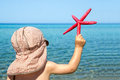 Little boy holding sea star Royalty Free Stock Photo