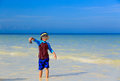 Little boy holding starfish at summer beach Royalty Free Stock Photo