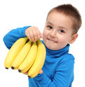 Little boy holds bananas Royalty Free Stock Photo