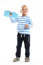 Little boy holds in his hand a paper airplane Royalty Free Stock Image