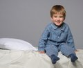 Little boy at home wearing blue pyjamas in bed Royalty Free Stock Photography