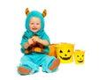 Little boy in horned Halloween monster costume Royalty Free Stock Photo