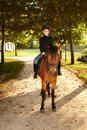 Little boy on horseback young sitting in the nature Royalty Free Stock Photo