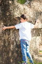 Little boy hug a big tree outdoor Royalty Free Stock Photo