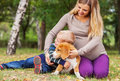 Little boy hugs his pet on walk happy family leisure with in autumn park Royalty Free Stock Photos