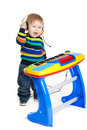 Little boy and the keyboard on white background. funny boy baby. Royalty Free Stock Photo