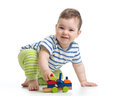Little boy kid playing with block toys isolated