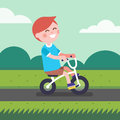 Little boy kid riding bicycle on a park bike path