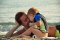 Little boy kissing his mother Royalty Free Stock Photo