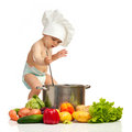 Little boy with ladle, casserole, and vegetables Stock Image