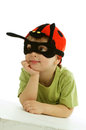 Little boy in ladybug hat mask and leaning on hands white surface isolated on white background Stock Image