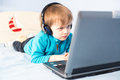 Little boy with laptop Royalty Free Stock Photos