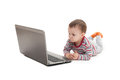 Little boy and laptop isolated lying in front of on white Stock Photos