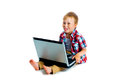 Little boy with a laptop sitting on the floor Royalty Free Stock Photo