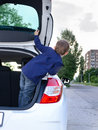Little boy leaning out of the back of a car Royalty Free Stock Photo