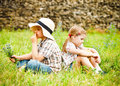 Little boy and little girl near the country house Stock Photo