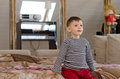 Little boy with a look of amazement on his face sitting the edge bed staring ahead big wide eyes Royalty Free Stock Images