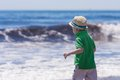 Little boy looking at big ocean waves Royalty Free Stock Photo