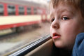 Little boy looking out the train window Stock Photo