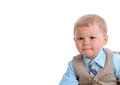Little boy looks seriously at white background Stock Photography