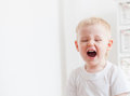 Little boy loudly screaming home Stock Images