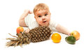 Little boy lying with fruits isolated on white Stock Image