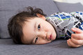 Little boy lying on sofa and make funny face Stock Photo