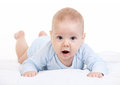 Little boy lying on stomach and looking at camera over white background Royalty Free Stock Photos