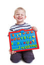 Little boy with magnetic board Stock Images
