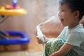 Little boy makes inhalation at home, taking medication to bronchial tubes. Royalty Free Stock Photo