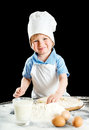 Little boy making pizza or pasta dough Royalty Free Stock Photo