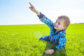 Little boy on meadow green grass Stock Photo