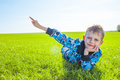 Little boy on meadow green grass Royalty Free Stock Photography