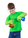 Little boy mixing a chemical liquids Royalty Free Stock Photo