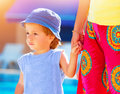 Little boy with mom outdoors closeup portrait of cute keep s hand and walking relaxation near poolside summer vacation loving Stock Photo