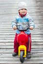 Little boy on motorbike Stock Images