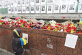Little boy near memory wall kyiv ukraine march with ukrainian flag stands with photos of killed protesters in center of kyiv Stock Image